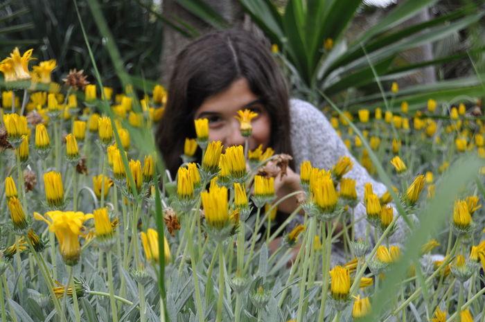 Flowers Peeking Girl Happy Happy People In The Garden Young Girl