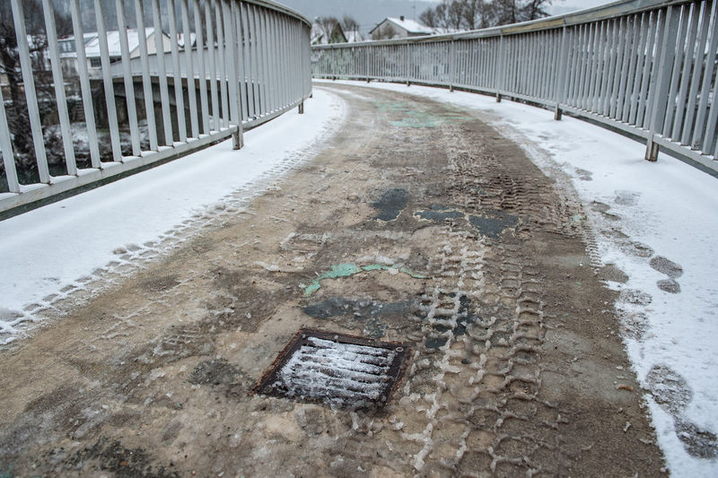 Bridge Day Footsteps In The Snow No People Outdoors Snow Slush Tire Mrks Ugly Water Winter