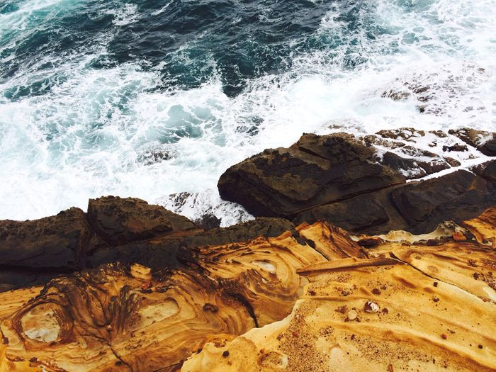 High angle view of rock formation at sea