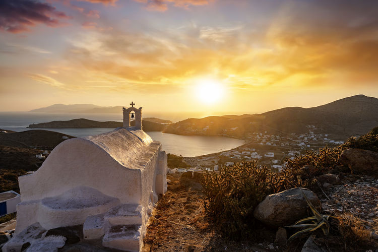 Summer sunset over the Aegean island of Ios, Cyclades, Greece Sunset Sky Scenics - Nature Cloud - Sky Sunlight Rock Orange Color Architecture Tranquility Tranquil Scene No People Sun Water Beauty In Nature Greece Ios Island Cyclades Summer Mountain Church Orthodox Greek Mediterranean  Europe
