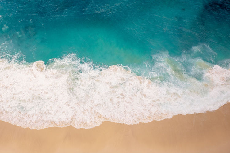 The water of the ocean crashes onto the beach. Water Sea Wave Aquatic Sport Motion Surfing Land Nature Beach Sport Power In Nature Beauty In Nature Outdoors Day Sand Power Turquoise Colored Breaking Purity Stay Out