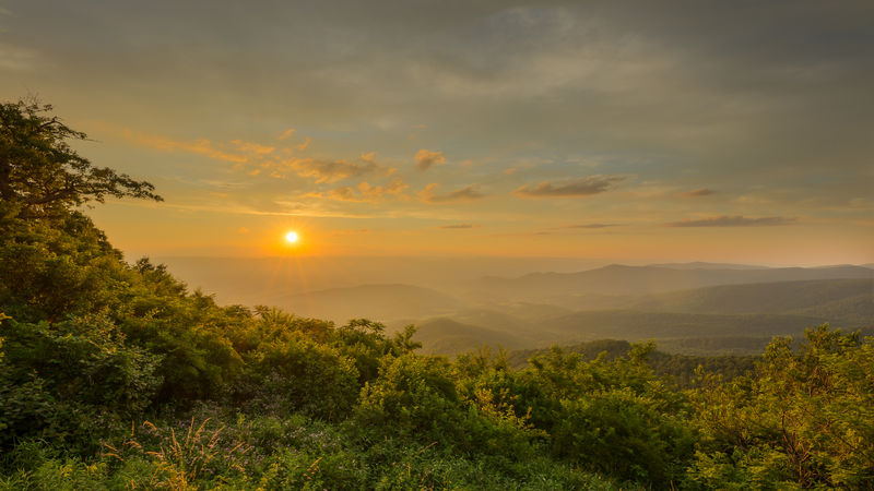 Sunset in Shenandoah National Park. The sun moments before disappearing behind the mountains and setting for the evening National Park Shenandoah National Park Beauty In Nature Cloud - Sky Forest Landscape Mountain Mountain Range Mountains Nature No People Orange Color Outdoors Park Scenics Sky Sun Sunset Tranquility Tree Yellow