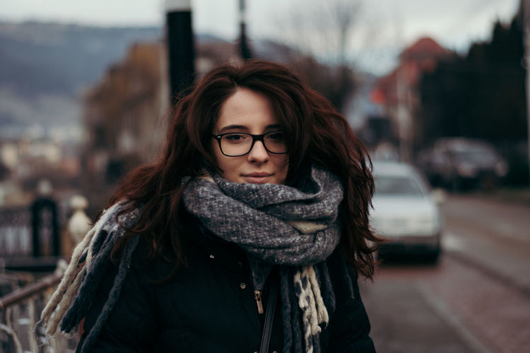Portrait of beautiful woman in city during winter