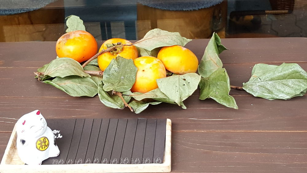 Citrus Fruit Close-up Container Day Food Food And Drink Freshness Fruit Healthy Eating Leaf Leaves Nature No People Orange Orange Color Outdoors Plant Plant Part Still Life Table Wellbeing Wood - Material