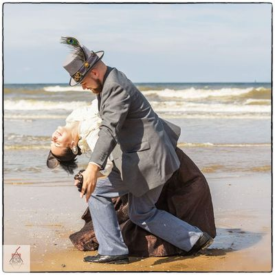 Steampunk Sea Horizon Over Water Beach Full Length Auto Post Production Filter Water Leisure Activity Lifestyles Sitting Casual Clothing Transfer Print Side View Couple - Relationship Sand Shore Crouching Relaxation Young Adult Focus On Foreground Beauty In Nature