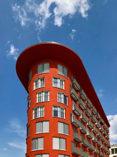 Low angle view of red building against sky