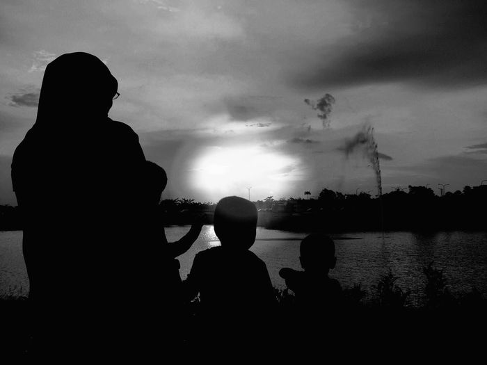 Silhouette of mother with children