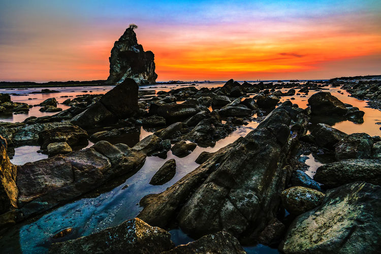 sunset on sawarna Landscape Sony SONY A7III Landscape_photography SonyA7III Sony2470mm Sonyalpha INDONESIA Photography Indonesia Photography  Jakartaphotography Mood Beauty In Nature Nature Golden Hour Karang Explore Exploreindonesia Sunset Beach Sea Water Sky Horizon Over Water Place Of Worship Low Tide EyeEmNewHere EyeEmNewHere