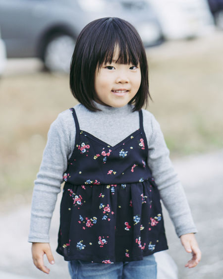 Childhood Child Focus On Foreground One Person Females Girls Standing Looking At Camera Front View Casual Clothing Portrait Bangs Women Real People Cute Innocence Day Waist Up Hairstyle Outdoors