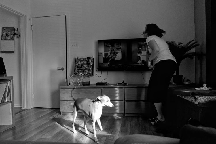 Man with dog standing at home