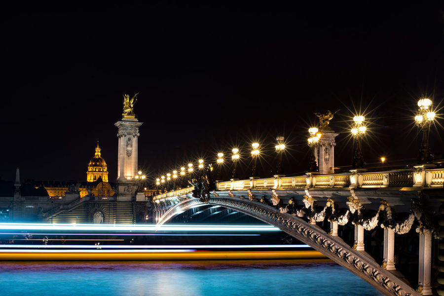 Architecture Bridge - Man Made Structure Built Structure City City Life Cityscape Illuminated Light Trail Long Exposure Motion Night No People Outdoors Politics And Government Pont Alexander III Sky Street Light Tower Traffic Transportation Travel Destinations
