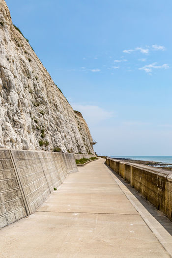The white chalk cliffs along Brightons undercliff path Brighton Chalk Cliffs Cliffs Architecture Beauty In Nature Built Structure Concrete Day Diminishing Perspective Direction Footpath Horizon Horizon Over Water Land Nature No People Outdoors Scenics - Nature Sea Sky Sussex The Way Forward Undercliff Path Wall Water