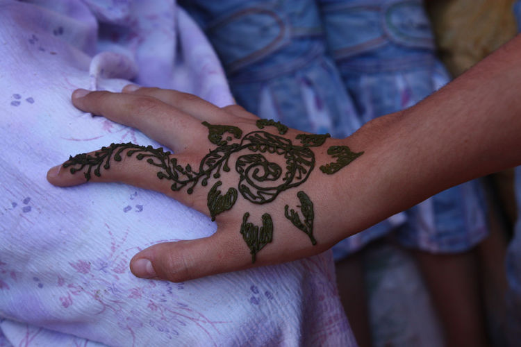 Henna Tattoo On The Hand Of A Woman