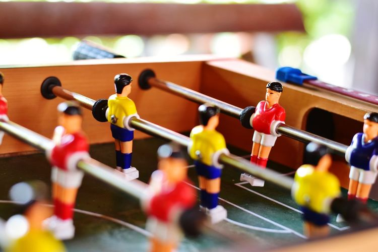 Table football game, there are red and yellow players, soft focus. Blur Soft Focus Table Football Miniature Model Minimal Kicker Goal Fun Indoor Football Game Soccer Game Toy Wooden Table Retro Vintage Control Competition Sport Player Play EyeEm Selects Figurine  Red Close-up
