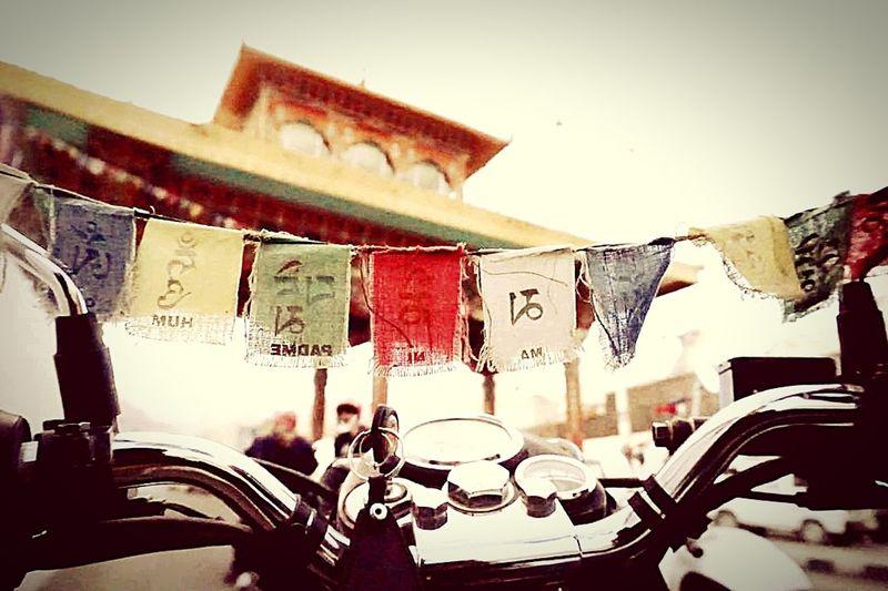 Biker Bullet Ride Mountain EyeEm Gallery EyeEm Nature Lover Randomclick Monastery Buddhism Flags Miniflags Leh Laddakh Trip Solotrip Wanderlust EyeEm Selects India EyeEm Best Shots Eye4photography  Drink Sky Close-up