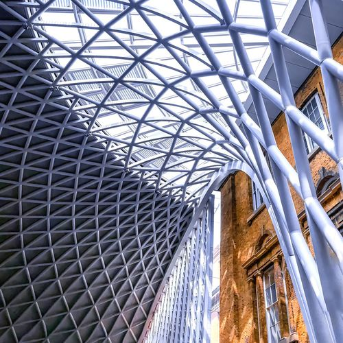 Curves of modern city London Kings Cross Built Structure Architecture Low Angle View Ceiling Pattern Indoors  No People Day Building Metal Sunlight Modern Glass - Material Travel Destinations Travel Design