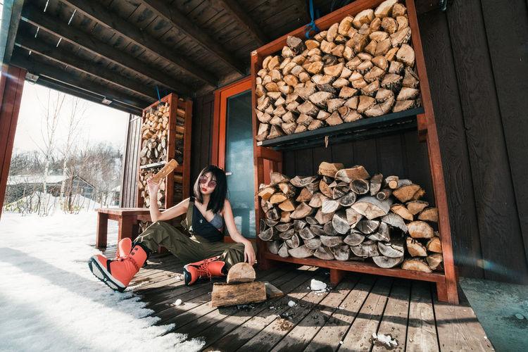 Portrait of man sitting on logs