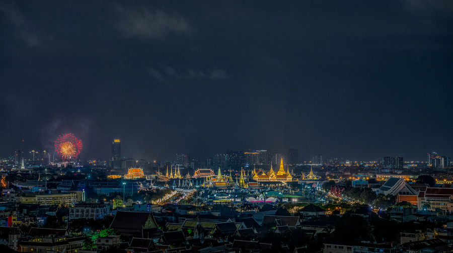 Sanam Luang Bangkok Thailand. Fireworks Wat Prakeaw Architecture Building Exterior Built Structure City Life Cityscape Cloud - Sky Crowded High Angle View Illuminated Landscape Night Office Building Exterior Pagoda Building Palace Skyscraper Temple Of The Emerald Budha Travel Destinations Urban Skyline