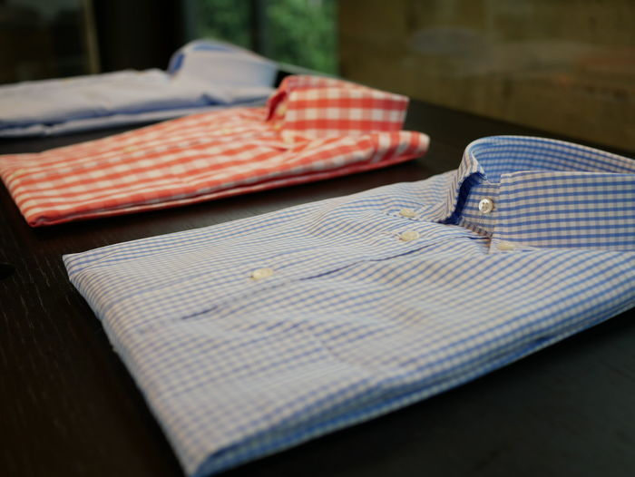 Close-up of folded shirts on table