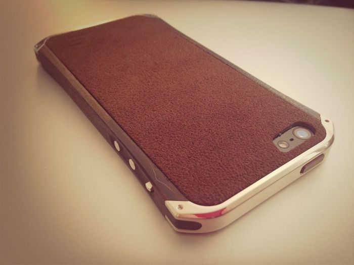 My new Ronin Element iPhone case for my 5!!!! Wood and metal!! Badass!!!