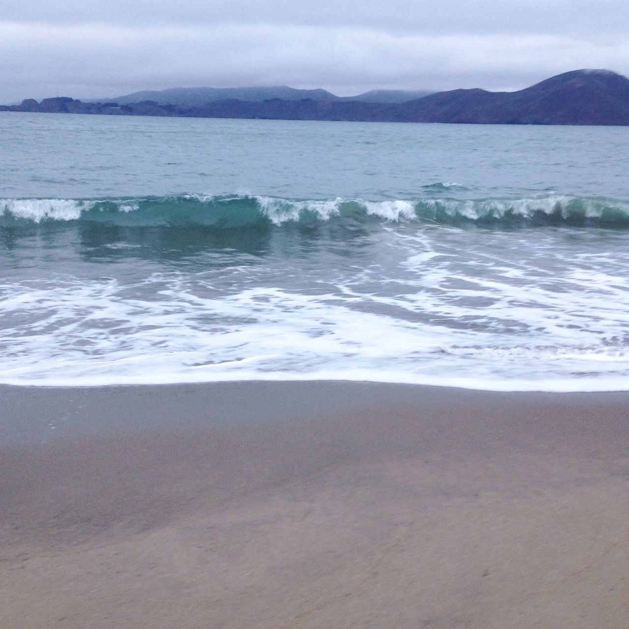 sea, nature, beauty in nature, water, scenics, tranquility, tranquil scene, no people, sky, beach, outdoors, mountain, sand, wave, day, landscape, horizon over water