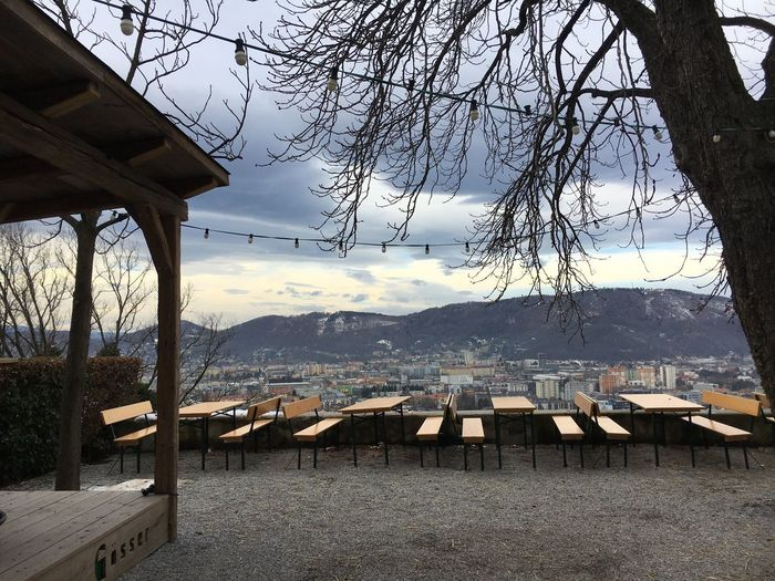 Scenic view of restaurant by mountains against sky