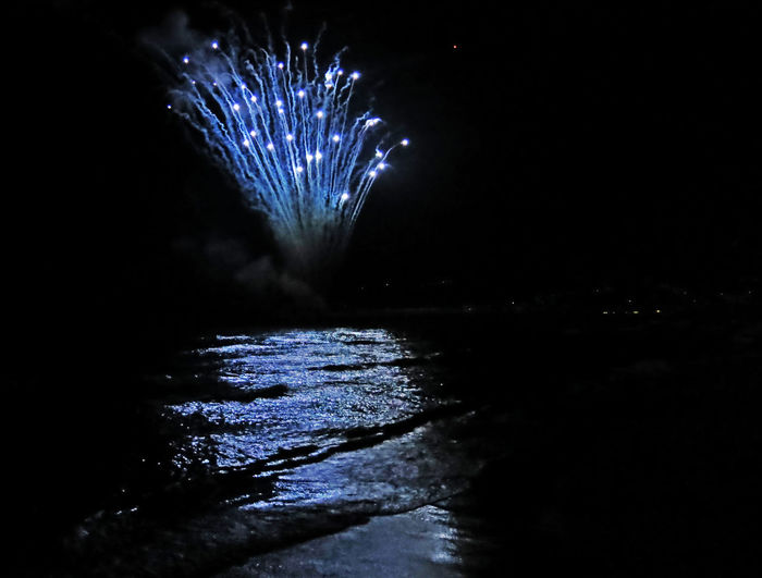Arts Culture And Entertainment Blue Blue Reflection Blue Sea Celebration Firework Firework Display Fireworks Fireworksphotography Motion New Year New Year Around The World New Year's Eve Fireworks Night No People Outdoors Reflection Sea Sky Water