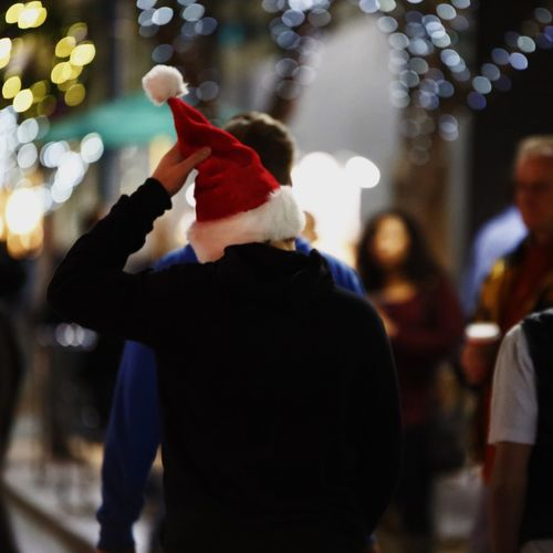 christmas in Santa monica blvd , California, United States Illuminated Rear View Standing Waist Up Focus On Foreground Incidental People Hat Night Group Of People Nightlife Crowd Occupation Blue Well-dressed Casual Stage - Performance Space Performance Event City
