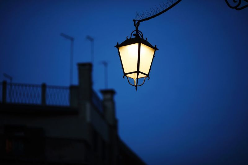 Lighting Equipment Low Angle View Sky Dusk Illuminated Hanging Night Street Light Light No People Architecture Street Nature Electricity  Built Structure Clear Sky Blue Electric Lamp Building Exterior Outdoors