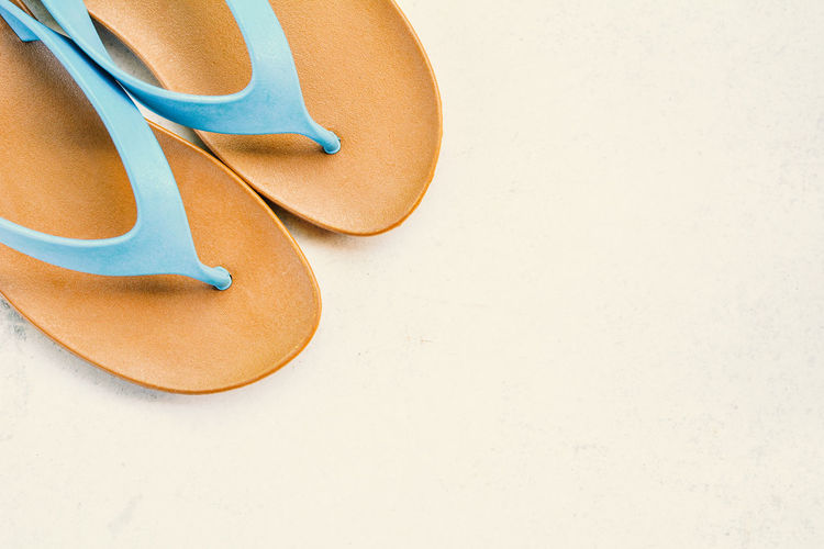 High angle view of slippers on white background