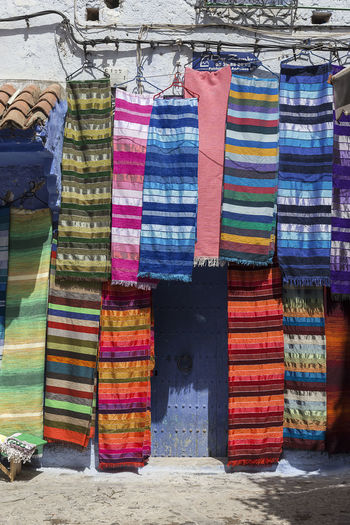Multi colored fabrics on display for sale in market
