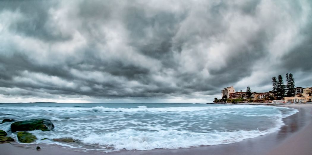 Panoramic view of sea against cloudy sky