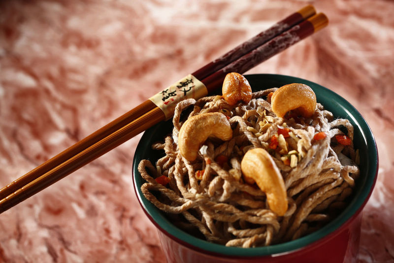 yakisoba Food Food And Drink Close-up No People Indoors  Healthy Eating Freshness Ready-to-eat Still Life High Angle View Table Yakisoba Bowl Chopsticks Nut Kitchen Utensil Spoon Wellbeing Focus On Foreground Nut - Food Selective Focus Meal Breakfast Temptation Chinese Food Shoyu