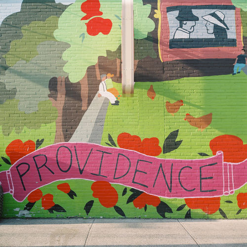 A colourful mural near Thayer Street on the Brown University campus in Providence, Rhode Island. A Art Brown University College Colorful Colors Colourful Colours Film Graffiti Green Mural Mural Art Outdoors P Painting People Rhode Island Rolleiflex Shadow Sidewalk Sun Text Thayer Street University