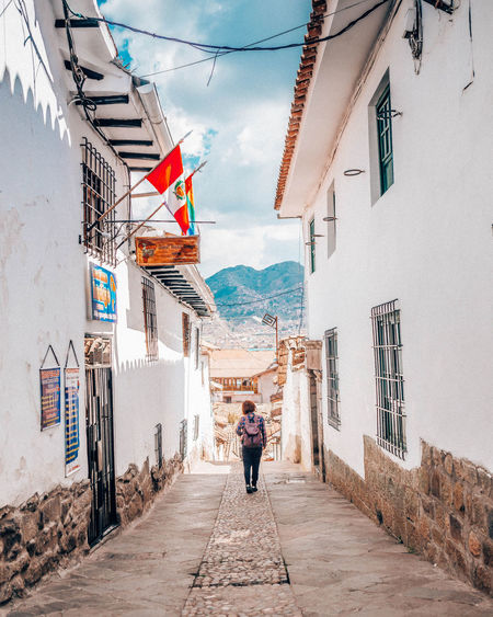 City Old Town Peru Tranquility Travel Alley Architecture Building Building Exterior Built Structure Canon City Cultures Day Direction Footpath Leisure Activity Lifestyles Outdoors Real People Standing The Way Forward Travel Destinations Walking Women The Traveler - 2018 EyeEm Awards #urbanana: The Urban Playground