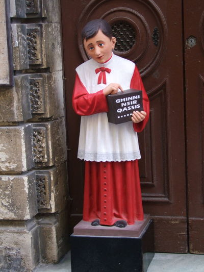 Choir Boy Collection Box, Valletta, Malta Valletta Malta Standing Front View Text Looking At Camera Communication Red And White Colour Costume Male Representation Collection Box Church Religion Collection Boy Statue Holding Full Frame Composition Outdoor Photography Fun Tourism Travel Destinations Symbolism Unusual