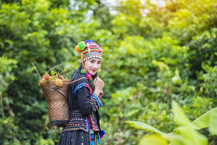 Full length of cute girl holding plant