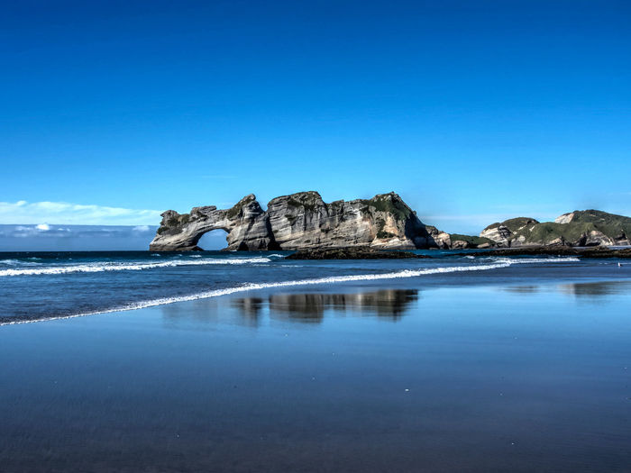 The arches at Wharariki beach, Golden Bay, New Zealand. I've noticed that Microsoft Windows 10 uses an image of these arches as a desktop. EyEmNewHere Wharariki Beauty In Nature Blue Clear Sky Day Golden Bay Nature No People Outdoors Scenics Sea Sky Tranquil Scene Tranquility Water Waterfront EyeEmNewHere An Eye For Travel