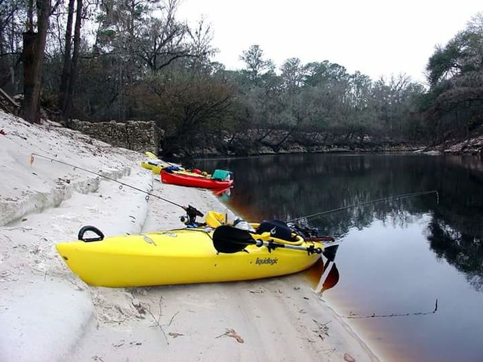 On the Suwannee River by the Spirit Of The Suwannee campground. Kayak Nautical Vessel Oar Yellow Leisure Activity Tree Day River Nature People Sport Vacations Outdoors Water Adult Sky One Person