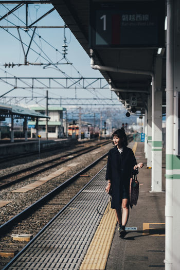 Ready to go Rail Transportation Track Railroad Track Transportation Railroad Station Public Transportation Railroad Station Platform Architecture One Person Full Length Mode Of Transportation Real People Built Structure Lifestyles Travel Businessman Men Young Adult Walking Outdoors Waiting