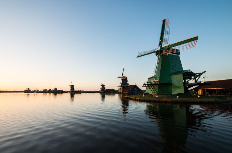 Zaanse schans, Holland - Traditional Dutch windmills with canal close Alternative Energy Blue Commercial Dock Crane Crane - Construction Machinery Environmental Conservation Mast Nature No People Outdoors Renewable Energy Ship Sky Traditional Windmill Tranquil Scene Tranquility Water Waterfront Wind Power Windmill