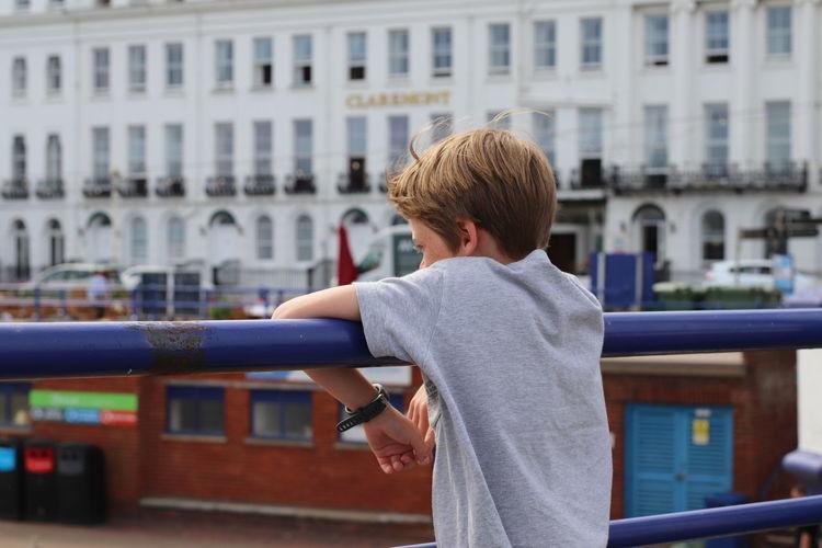 Boy leaning on railing