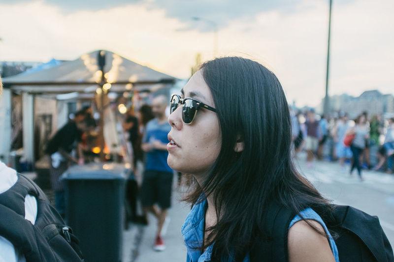 Portrait of Brunette Woman Wearing Sunglasses