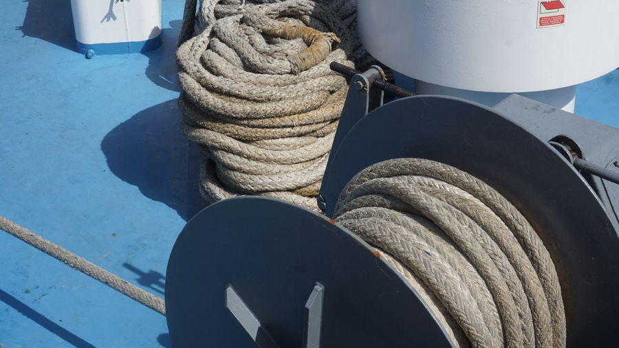 Nautical Vessel Rope Transportation Mode Of Transportation No People Day Close-up Tied Up Water Nature Strength Outdoors Sunlight High Angle View Stack Blue Rolled Up Connection Low Section Moored