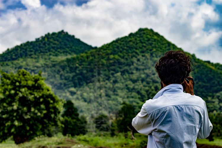 Rear View Adult One Person Nature Outdoors Men Back Young Adult Sky Tree Green Color Beauty In Nature Mountains Sunlight And Shadow Cloud - Sky Long Way To Home