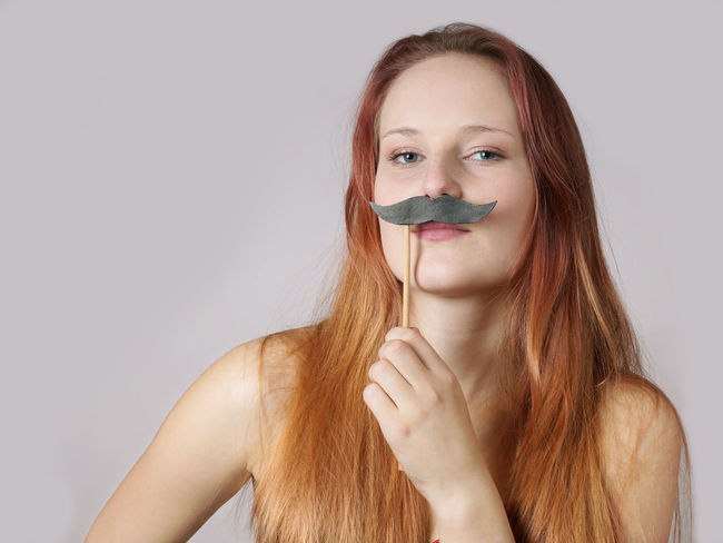 Beauty Copy Space Disguise Female Front View Fun Funny Gender Girl Headshot Long Hair Moustache Movember Person Portrait Studio Shot Woman Young Women