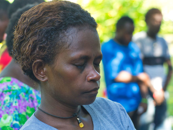 Praying for peace in Bougainville Inner Power Adolescence  Boys Casual Clothing Child Close-up Contemplation Day Females Focus On Foreground Headshot Lifestyles Looking Males  Mature Adult Mature Men Men Outdoors People Portrait Praying Real People Teenager The Portraitist - 2018 EyeEm Awards
