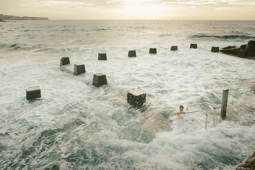Adult Adults Only Beach Commitment Coogee Day Determined Eastern Beaches Funny Male Nature One Man Only One Person Only Men Outdoors People Rock Pool Rough Sea Sand Sea Struggle Swamped Swimming Water Wave Adapted To The City Adapted To The City