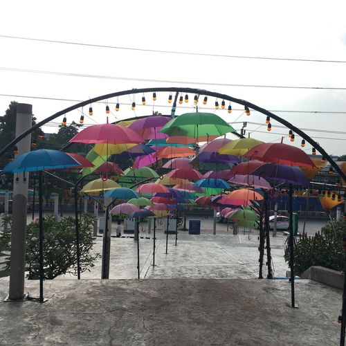 Arts Culture And Entertainment Multi Colored Sky Amusement Park Day Architecture Nature Decoration Amusement Park Ride Built Structure Incidental People Outdoors Playground Building Exterior Childhood Park - Man Made Space Park Hanging Fun Outdoor Play Equipment
