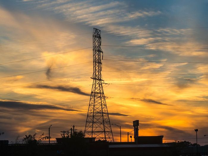 Sunset in East Peoria Sky Cloud - Sky Sunset Electricity Pylon Electricity  Silhouette Low Angle View Connection Tower Power Line  No People Power Supply Beauty In Nature Technology Outdoors Scenics Romantic Sky Nature Day Olympus Om-d E-m10